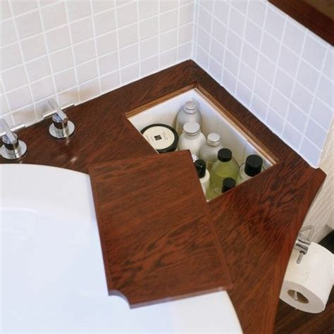 small bathroom storage ideas uk hidden storage storage and small bathrooms on pinterest
