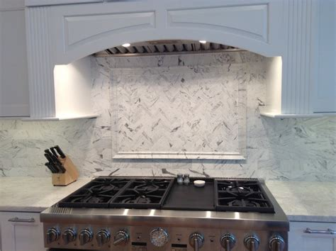 bianco venatino herringbone marble backsplash