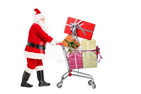 santa claus pushing a shopping cart stock photos