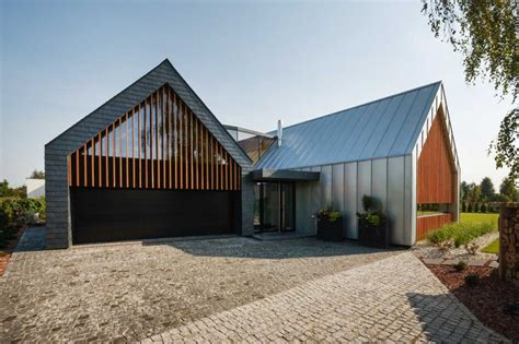 contemporary barn original residence in poland dictated by modern living