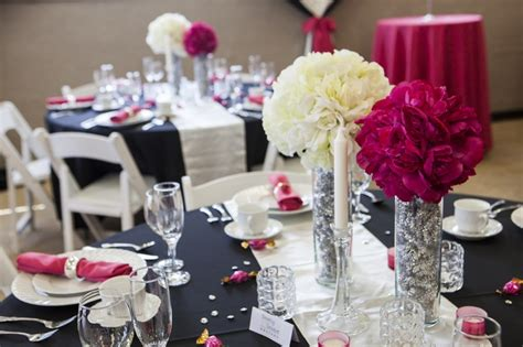 a modern black and fuschia wedding theme with lounge furniture rentals from http www
