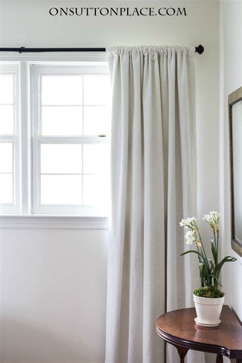 how to hang window treatments how to hang curtains like a pro on sutton place
