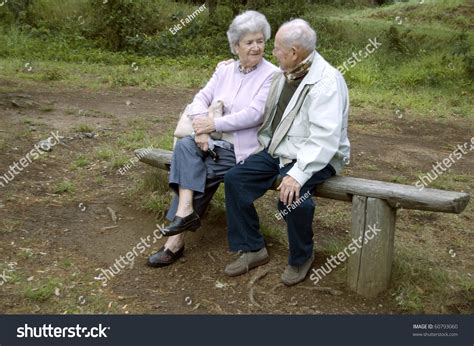 old couple on park bench old happy senior couple sitting on stock photo 60793060