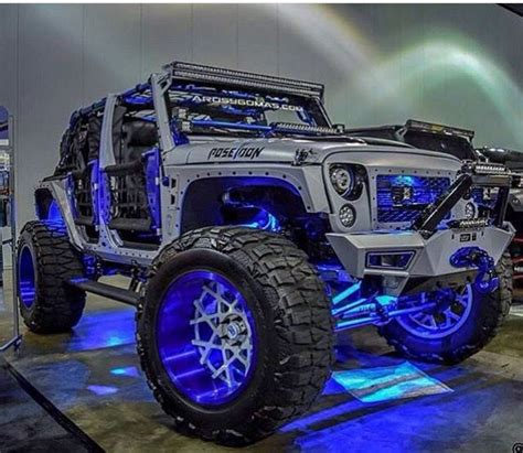 4 door jeep wrangler jacked up this silver jeep jk is decked out in blue lights and blue