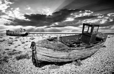 wooden boat graveyard fishing boat graveyard photograph by meirion matthias