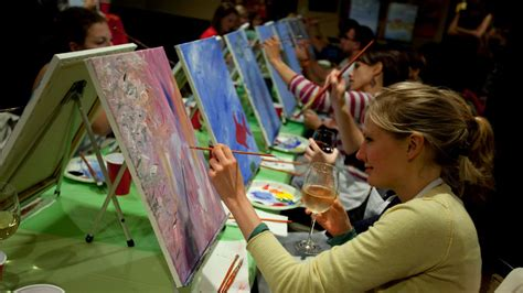 people painting paint nite combines art lessons and alcohol at bars and restaurants