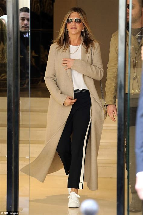 jennifer aniston casual jennifer aniston is casual in paris in a camel coat