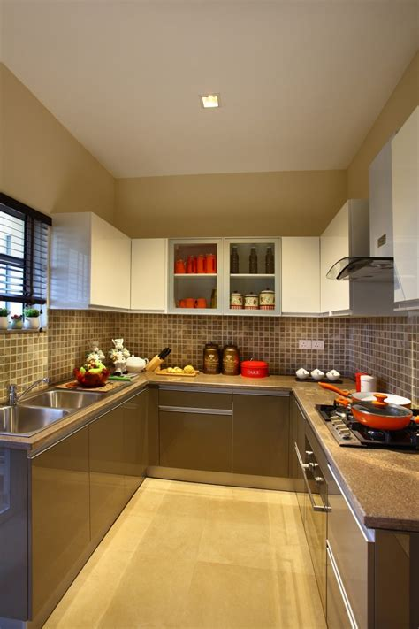 beige color modular kitchen  tiled wall  cabinets