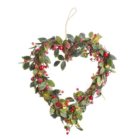 light up christmas wreath or garland by the christmas home