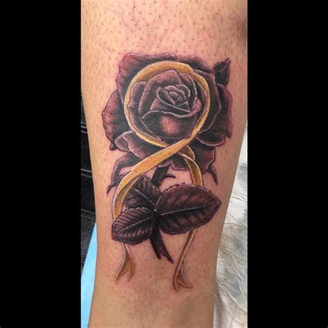 rose tattoo with ribbon gamble tattoos piercings tattoos black and gray