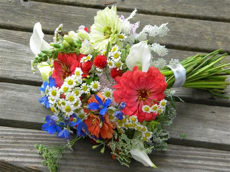 wedding flowers from springwell summer bouquet in warm coral and cobalt blue