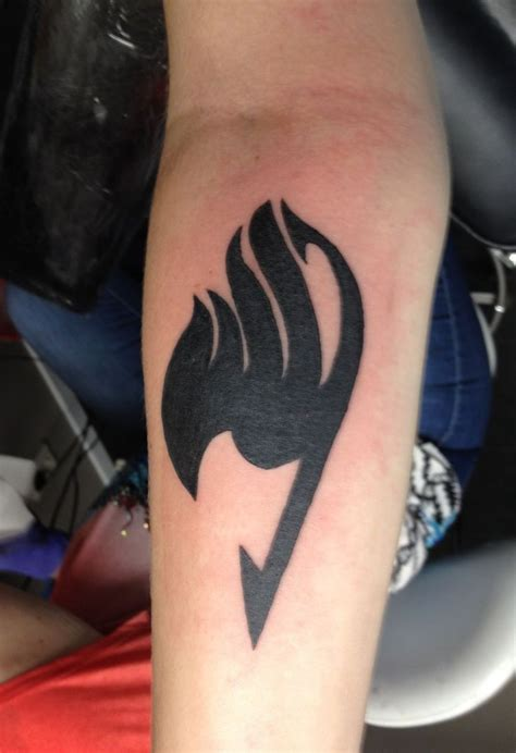 fairy tail tattoo on right shoulder