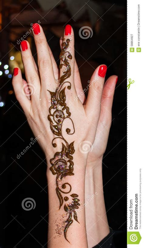 henna tattoo hand z rich with henna stock photo image 58864927
