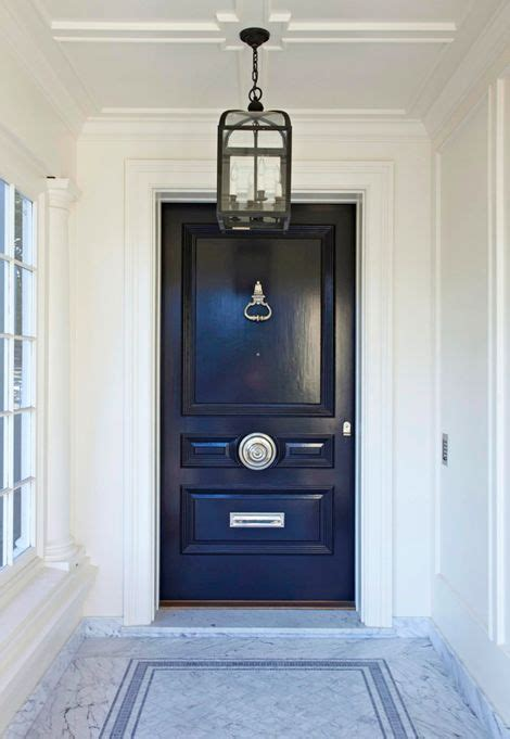 navy front door front door a white marble entrance at the front of the