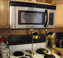 Installing Kitchen Cabinets Yourself Video how to install an over the range microwave jackclamp