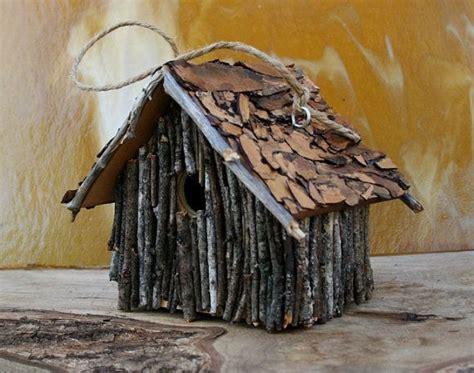live roof birdhouse tree bark roof outdoor birdhouse brown bark blue bird