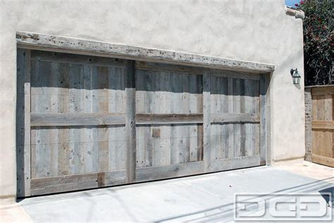 custom made reclaimed barn wood garage door in a rustic