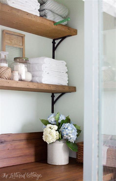 rustic laundry room home sweet home pinterest laundry room rustic wood shelves old door countertop