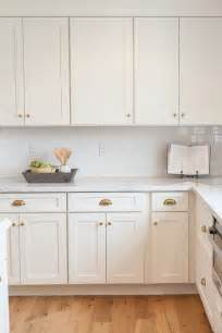aged brass hardware kitchens white