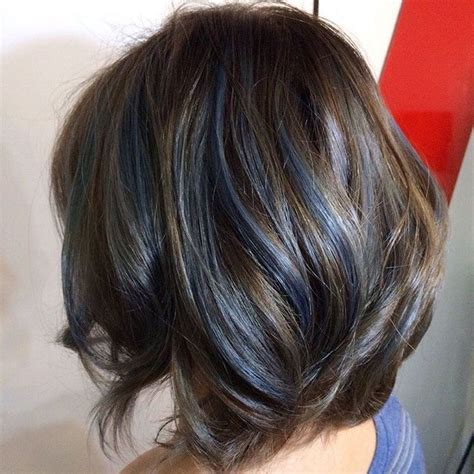 short modern hairstyles for women including blue streaks layered brown bob with blue streaks brown hair color