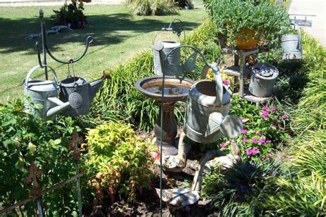 Backyard Market Gardening by Vintage Watering Cans In The Garden Flea Market Gardening