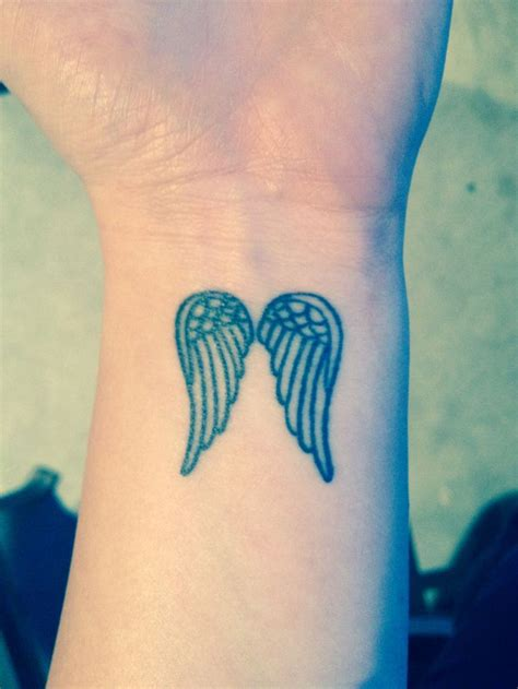 small angel wings tattoo on back left wrist small wings tattoos