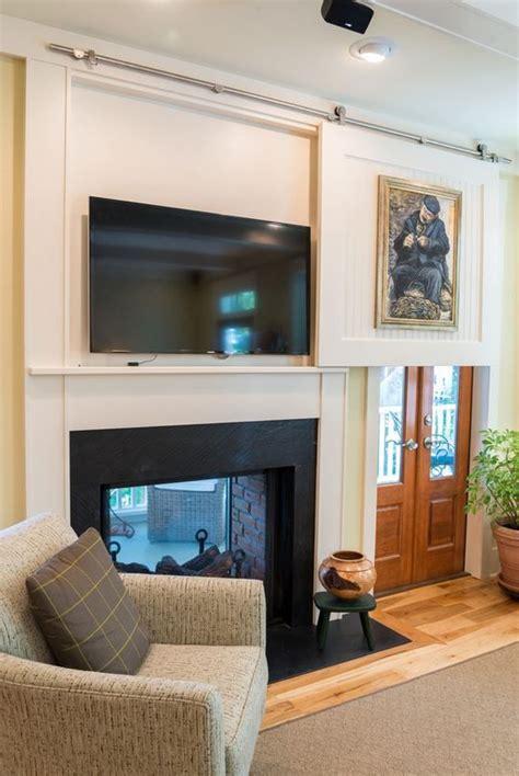 hide tv in living room best 25 hide tv ideas on tv tvs for dens and tv storage