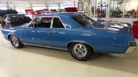 old cars and repair manuals free 1965 pontiac bonneville seat position control 1965 pontiac lemans 5008 miles blue 2 door hardtop 428 manual 6 speed classic pontiac le mans