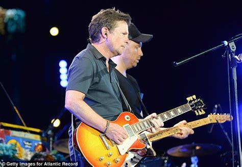 michael j fox with coldplay michael j fox joins coldplay on new jersey stage to