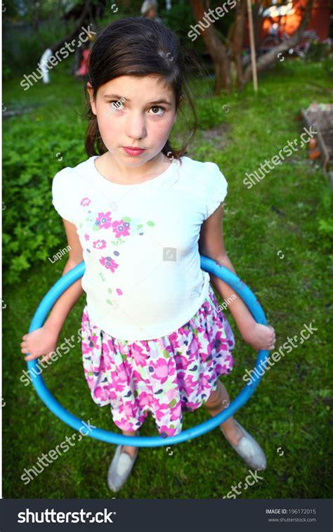 portrait preteen swimsuit holding hula hoop stock photo preteen school girl playing hula hoop stock photo