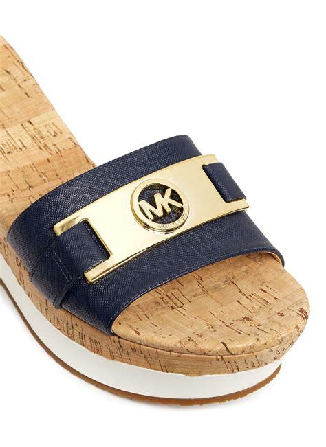 Sendal Wedges Jepit 7cm lyst michael kors warren leather cork wedge sandals in blue