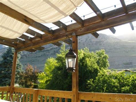 Outdoor Space Makeover Painted Floors Diy Drop Cloth Pergola Sun Shade Fabric