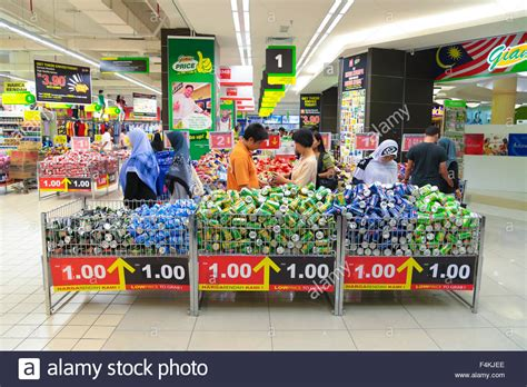 layout supermarket giant customers picking at softdrink cans offer bin at giant