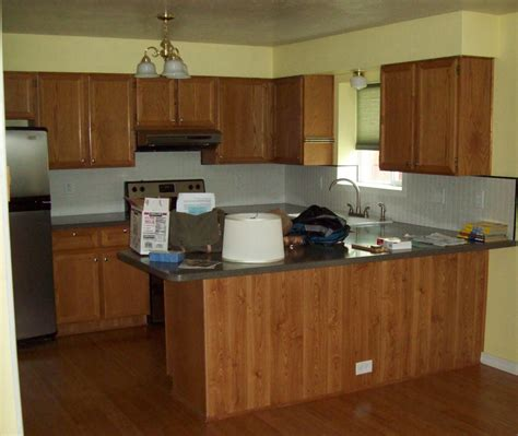 are oak kitchen cabinets outdated using old kitchen makeover oak cabinets old tile makeover