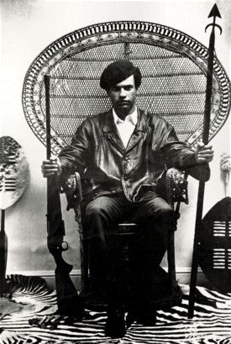 huey p newton black panther in a vintage peacock chair