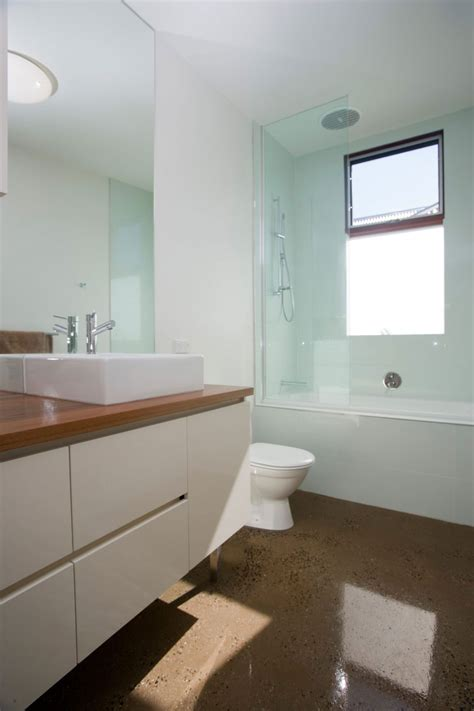 Good Small Bathroom Tiles Design #4: Small-modern-bathroom-single-house-design-with-white-interior-color-decorating-ideas-glass-room-divider-vanity-with-wooden-top-and-brown-marble-floor-tiles.jpg