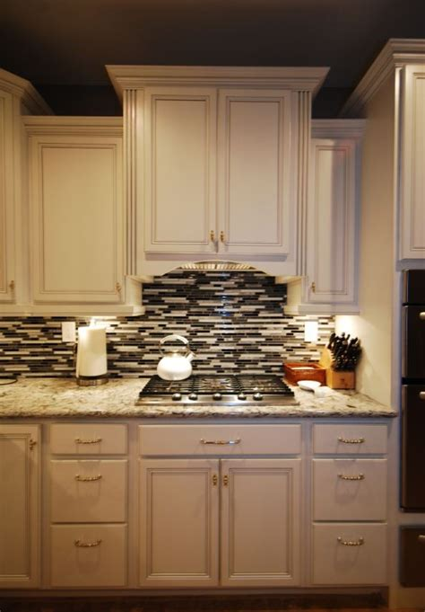 cambria praa sands white cabinets backsplash ideas cardell white with silver glaze and cambria praa sands