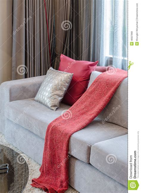 grey sofa with red cushions red pillow on grey sofa in living room stock photo image