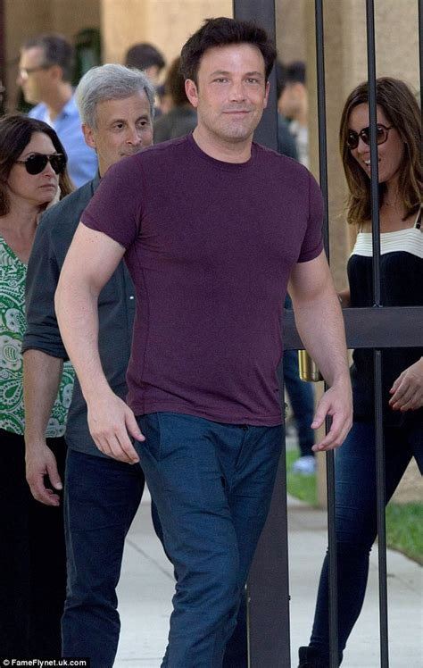 ben affleck smiles as he ben affleck grins after taking to to joke about