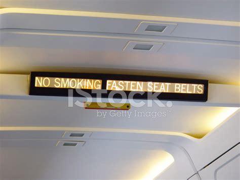 no smoking sign plane airplane sign no smoking fasten seat belts stock photos