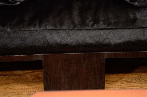 cowhide upholstery sculpted seating in ebonized oak with black cowhide