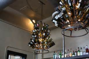 Diy How To Recycle Wine Bottle Into Chandelier Homesfeed Wine Bottle Chandelier Frame