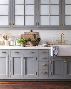 Brass hardware hardware pulls kitchen cabinetry blue gray color