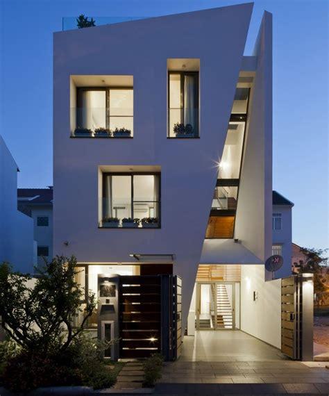 tre casa fachadas con aberturas de aluminio