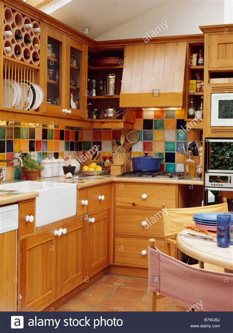 multi coloured wall tiles  kitchen dining room  fitted pine stock photo  alamy