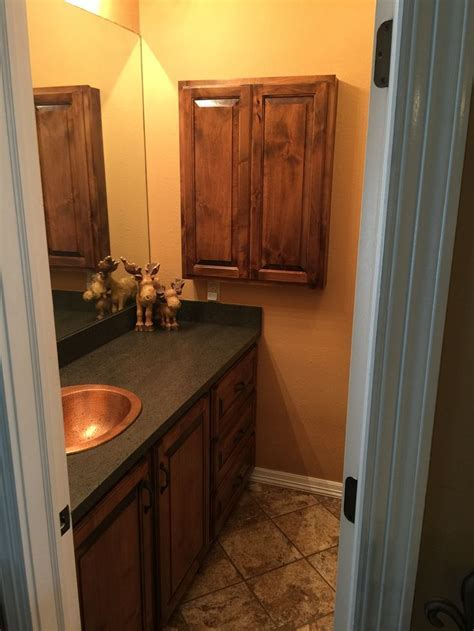 Custom bathroom vanity and matching medicine cabinet. Wood