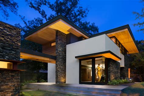 Hillside Cabin Plans cantilevered modern home with stacked stone triptych