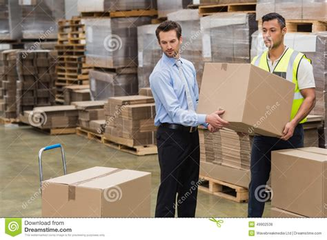how to put a box together warehouse worker and manager carrying a box together stock