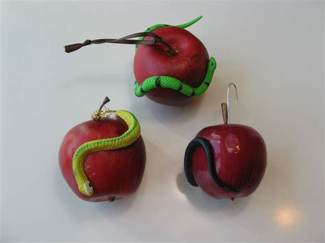 snake apple day 2 an apple and a snake wrapped around it tree