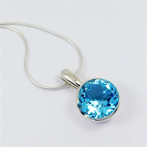 silver cocktail pendant with swiss blue topaz 163 280 00